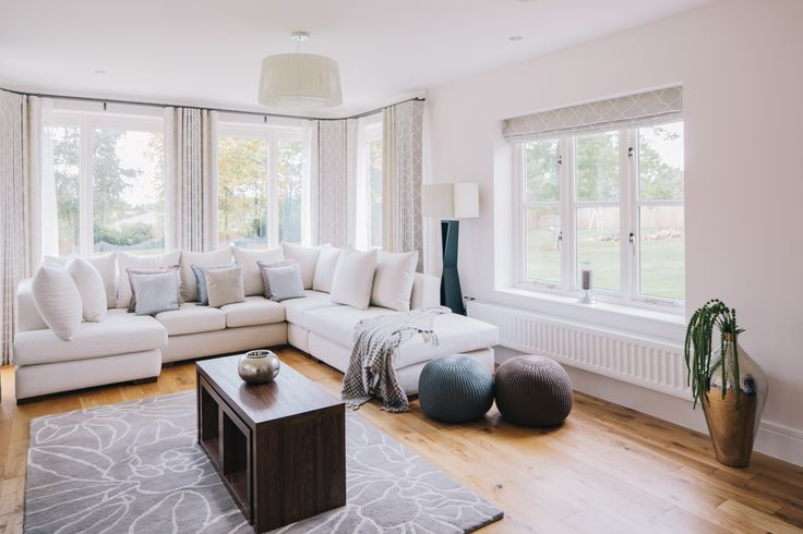Using various neutral tones and textures creates a fresh, yet cosy living room
