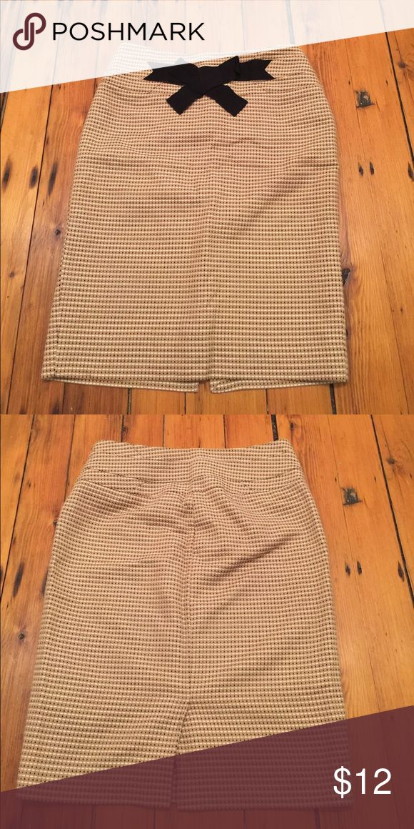 Tan pencil skirt Gorgeous tan colored pencil skirt with black and cream dots. Super cute bow on the top. Very flattering. The Limited Skirts Pencil