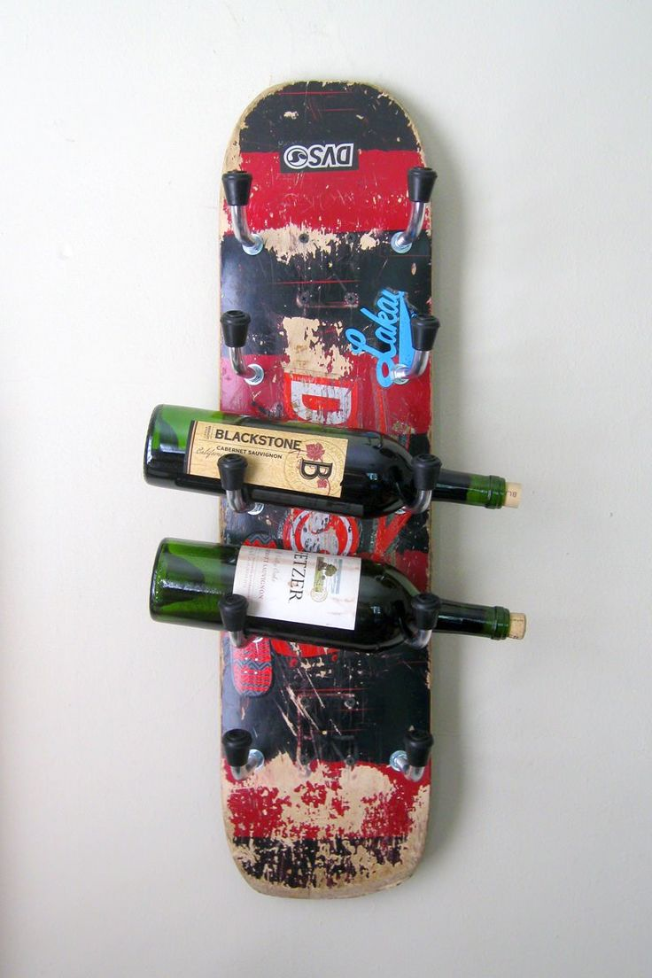 Check out this unique wine rack I made from an old skateboard deck. Nuts and bolts (covered with clear tubing) hold each bottle. Black rubber tips also hel