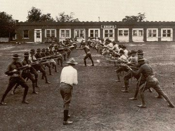 The Student Army Training Corps pracices a bayonet drill on  the parade grounds of Grubbs Vocational College  UTA Photograph Collection