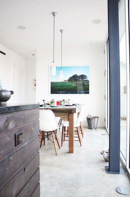 Eames shell chairs paired with a rustic dining table