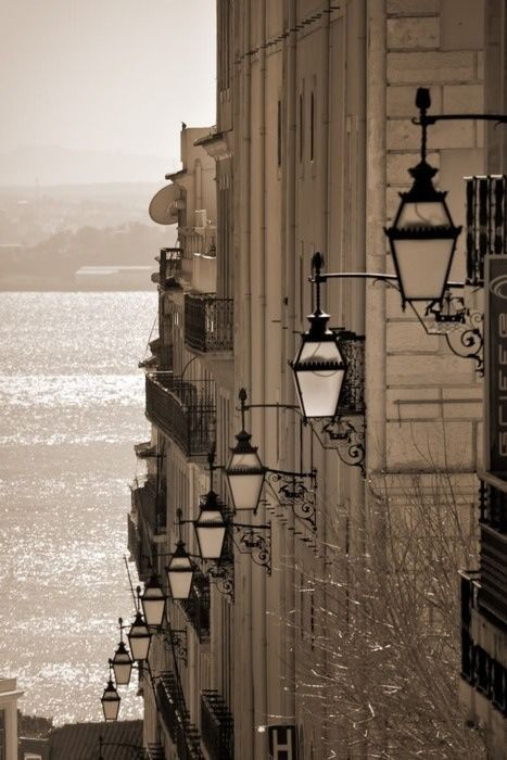 Travel Inspiration for Portugal - Lisboa - going down the hill heading the riverside. Look at the beautiful traditional street lamps! #Portugal