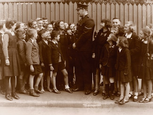 NSW police foot constable with school children circa 1930  (love the barefoot boy)