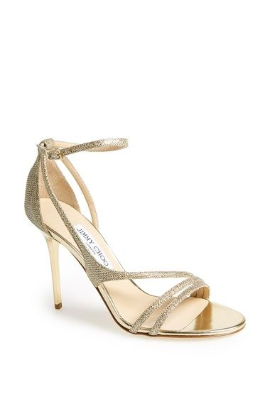 Gold strappy sandals by Jimmy Choo