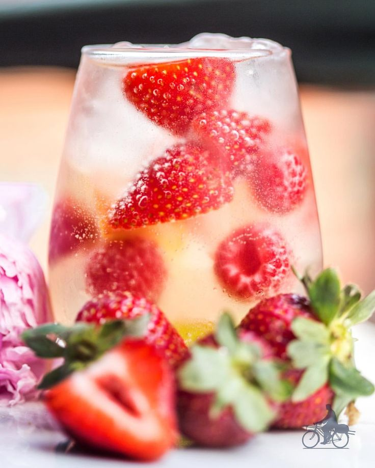 Taste the sweet scent of spring in every satiating sip of Sangria Flora: Dry White Wine or Sauvignon Blanc, St-Germain, fresh peaches, strawberries, raspberries, and grapes. #stgermaindrinks