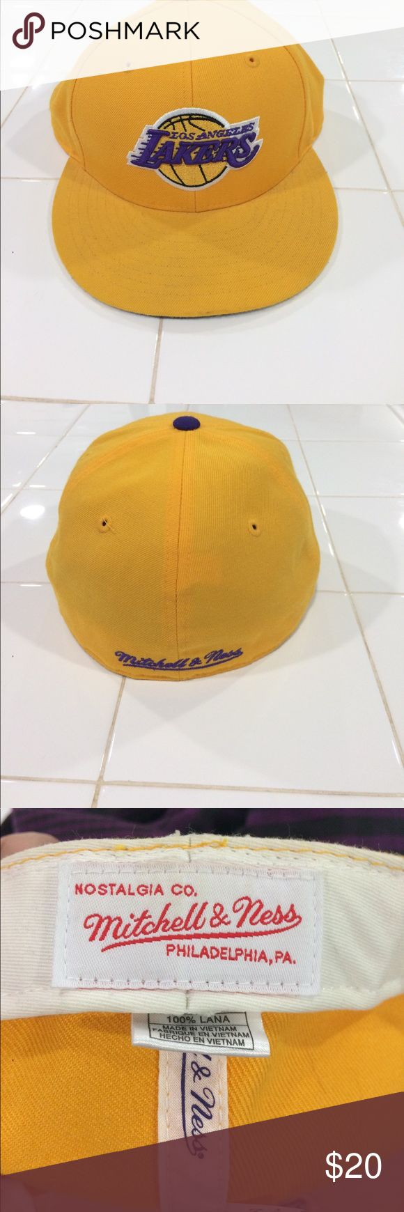 Mitchell & Ness Fitted Los Angeles Lakers Cap Mitchell & Ness Fitted Los Angeles Lakers Cap                     New without tags                                              Colors: Yellow, Purple, White (inside of cap)                       No Holes, Rips, or Stains                                      * From a Smoke and Pet Free Home                   Size: 7 1/2 Mitchell & Ness Accessories Hats