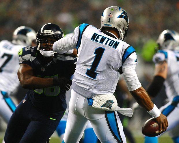 Carolina Panthers quarterback Cam Newton (1) is pressured by Seattle Seahawks…