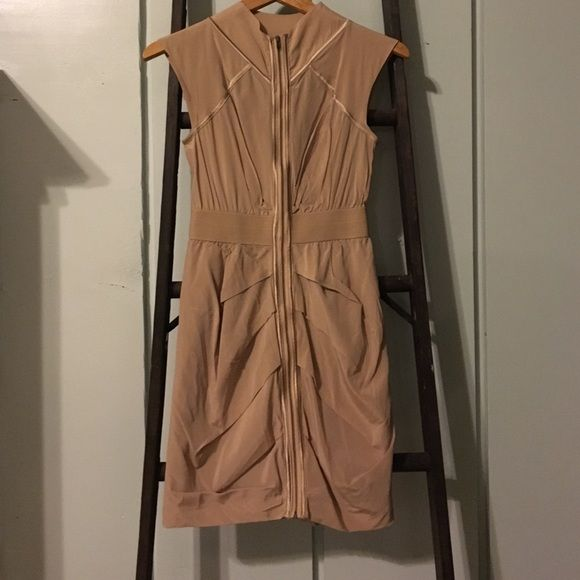 Bebe nude zip up dress Zipper all the way up the dress. Thee is one spot pictured above that the zipper is coming loose. Probably wouldn't even notice if I hadn't said it. The dress is mainly silk. bebe Dresses