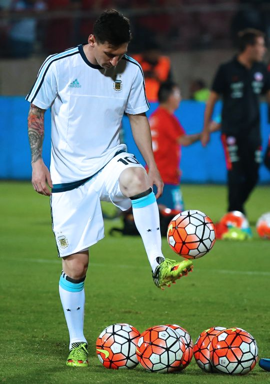 Lionel Messi warms up before the start of the Russia 2018 FIFA World Cup South American Qualifiers' football match between Chile and Argentina, in Santiago on March 24, 2016.
