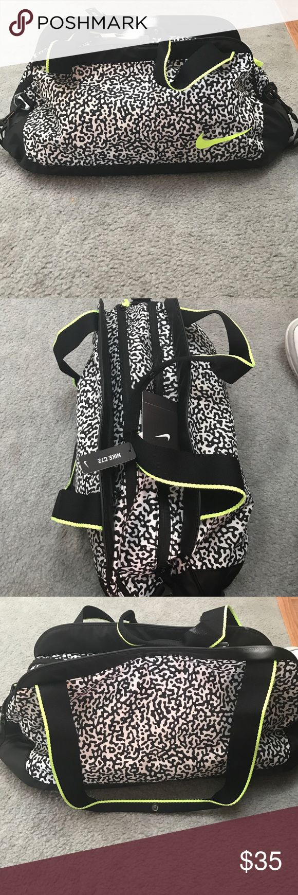 Nike cheetah print duffle bag Nike duffle bag with cheetah black and white print and neon black and yellow straps. Still has tags on and has multiple zipper pockets. Perfect size for the gym Nike Bags Totes