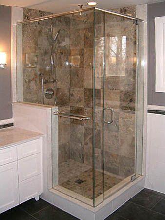 glass shower stall next to vanity