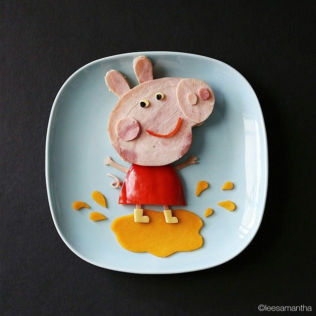 Lee Samantha, Food Artist Peppa loves jumping in muddy puddles! Oink! Ingredients - Fresh village bread  - Ham  - Red capsicum  - Cheese slice (light yellow for the eyes and boots)  - Cheddar cheese (darker yellow)  - Nori (eyes)