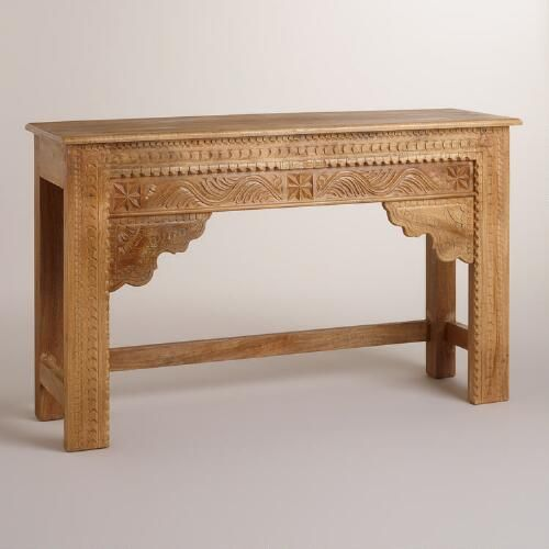 A stunning addition to the entryway or living room, our wood console table is crafted by artisans in Rajasthan, India, with hand-carved floral designs and a warm natural finish.