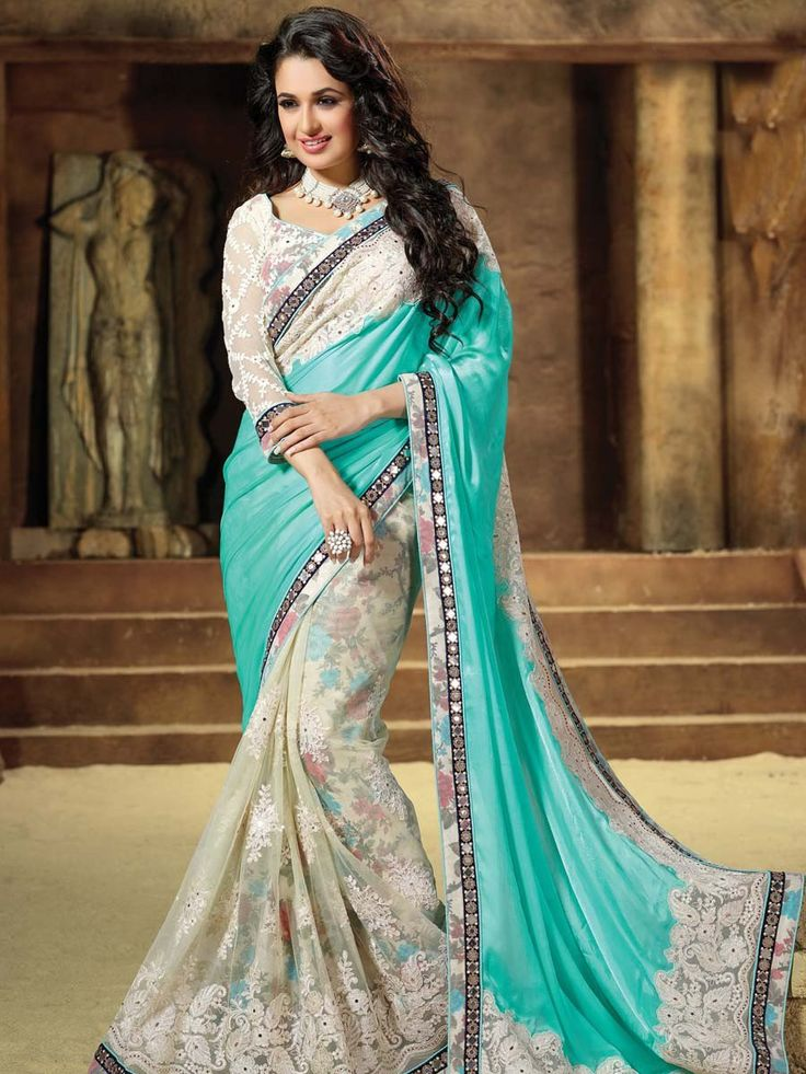 Prominent net, satin effect chiffon saree in cream, aqua color with floral print inner and resham, kundan work. Item code: SEH2503 http://www.bharatplaza.com/new-arrivals/sarees.html