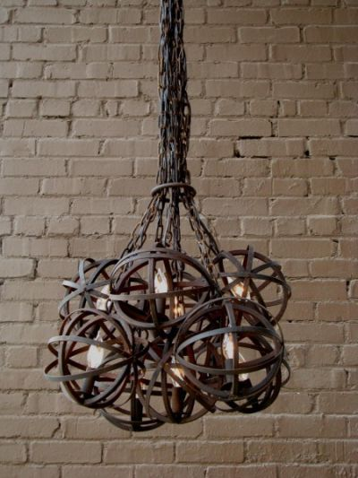 Daven Chandelier is truly unique! 9 light fixtures bundle together and  blend rustic and industrial style to create lighting statement sure to catch everyone's eye!