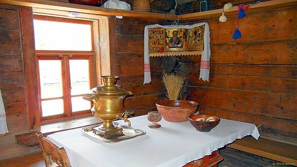 Samovar and the Icon corner in Russian log house.