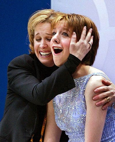 Sarah Hughes is hugged by her coach, Robin Wagner, after her scores are announced.