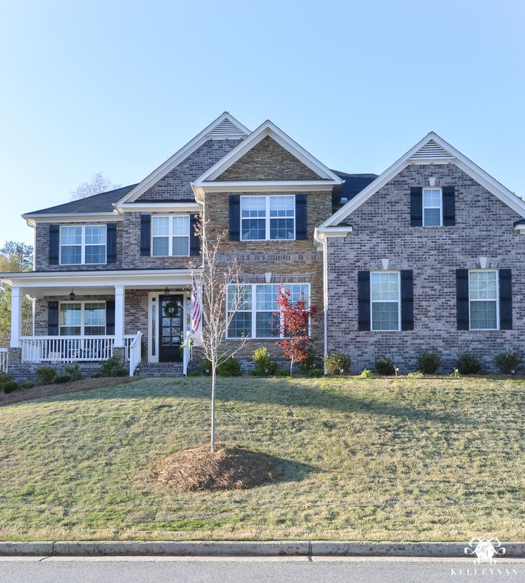 Craftsman Style Home with Rock and Brick in Spring
