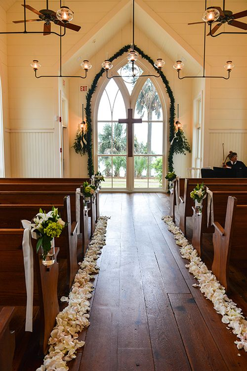 Magnolia and white flowers to line the church's aisle | @donnavb | Brides.com