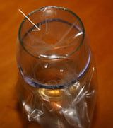 Insect trap (fruit flies) To make a vinegar trap, create a funnel with a plastic baggie. Cut a hole just large enough for fruit flies to pass through, but small enough so they can't escape easily.  Make a funnel with a plastic baggie.