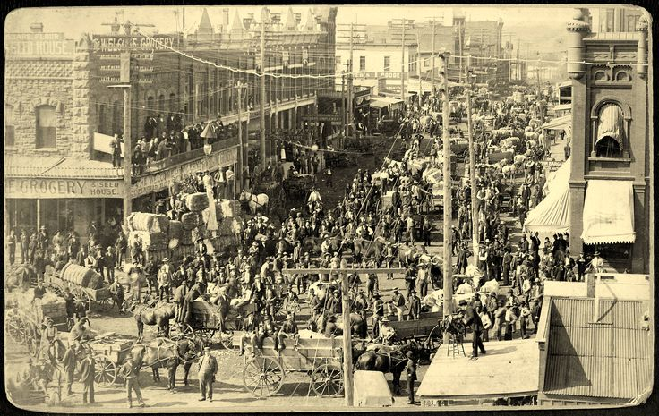 Guthrie Cotton Market. Peak of trading on Harrison Avenue is captured by Photographer Swearingen, after 1893