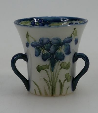 Rare 20th century Pottery, Antique, Collectors and Fine Art Auction – Lot 762 – William Moorcroft MacIntyre Miniature tyg vase decorated with violets C1908 & signed to base, height 5.25cm.  Sale Price £820.00.