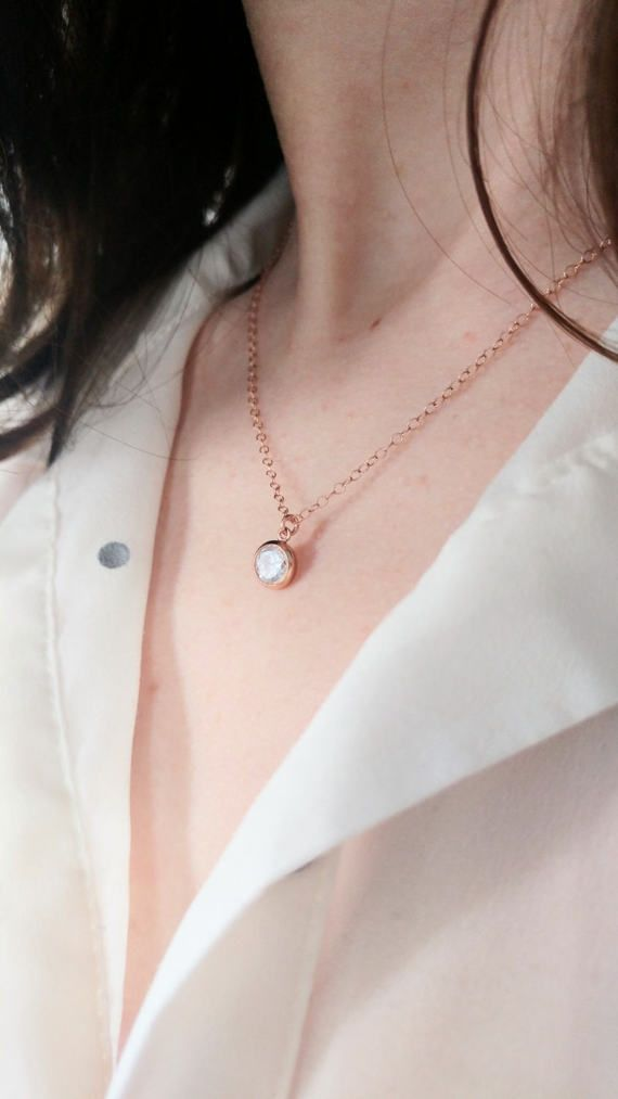 Dainty minimalist 14k rose gold filled necklace with a 6 mm cubic zirconia (CZ) pendant. 40 cm long. Spring ring clasp. Handmade. ................... SUMMARY  + 6 mm cubic zirconia + 40 cm long + Fine 14k rose gold filled chain + Spring ring clasp. + Handmade.  + Shipped in a Nice little Gift Packaging. ................... PLEASE READ OUR POLICIES: https://www.etsy.com/ca-fr/shop/PeaseJewelry?ref=hdr_shop_menu#policies ................... FOLLOW US: Facebook: htt...