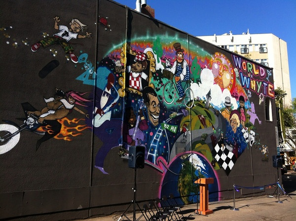 The mural, World on Whyte, by street artists Trevor Peters and Shane Berney, is an abstract collage of the landmarks, activities and culture Whyte Avenue is known for.
