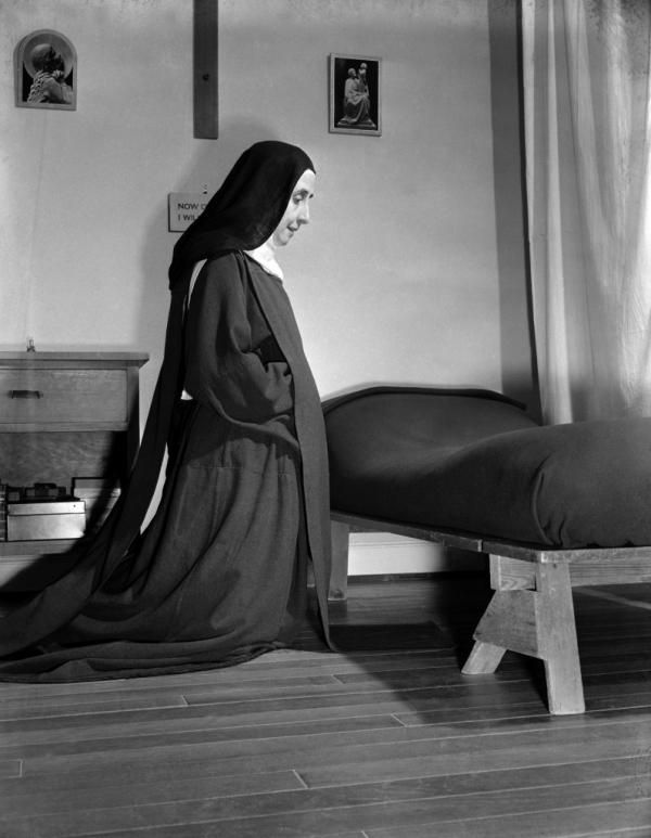 kneeler in cell | Pictured kneeling in prayer in her cell is one of the Carmelite nuns ...