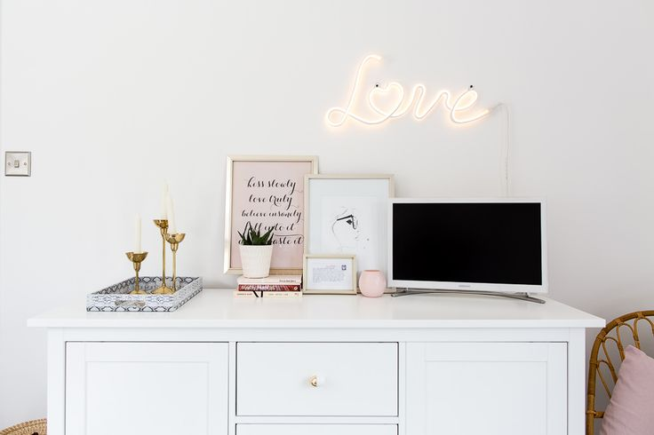 Love neon sign | Ideas for decorating and adorning walls without using standard picture frames, including using hanging pennants, propped shutters, macrame and antlers