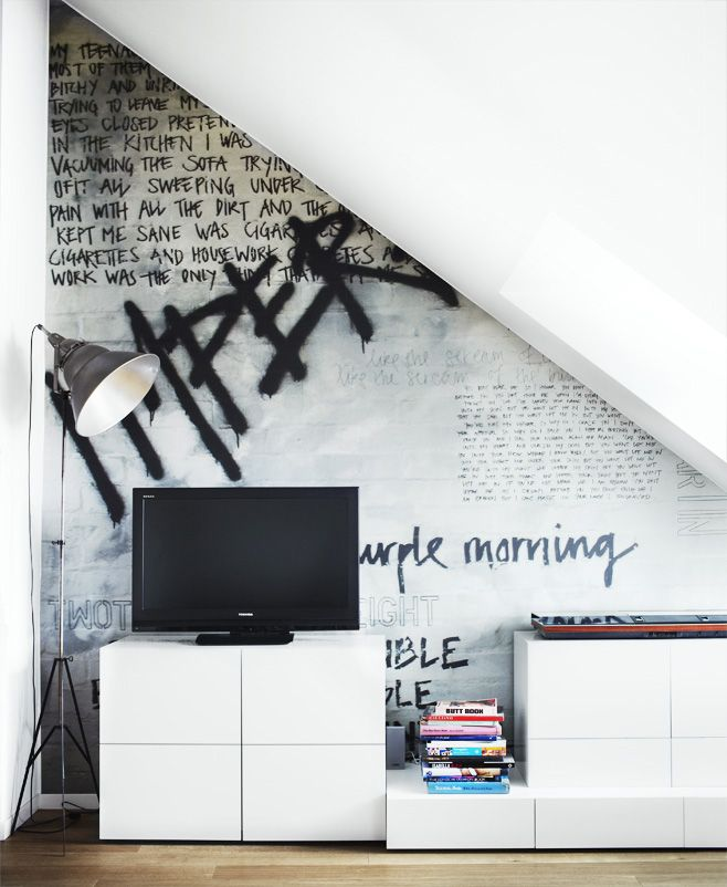 black handwriting on wall- different fonts + sizes. good contrast with sleek + modern furniture. for upstairs.