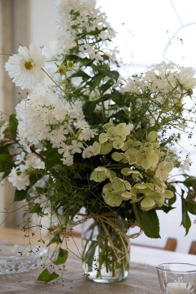 Garden flowers in jars - festival wedding - green wedding