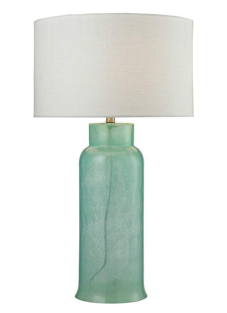 Reminiscent of an imposing maritime lighthouse, the lamp is finished with a textured white linen shade. Gorgeous lighting to add to your coastal home!