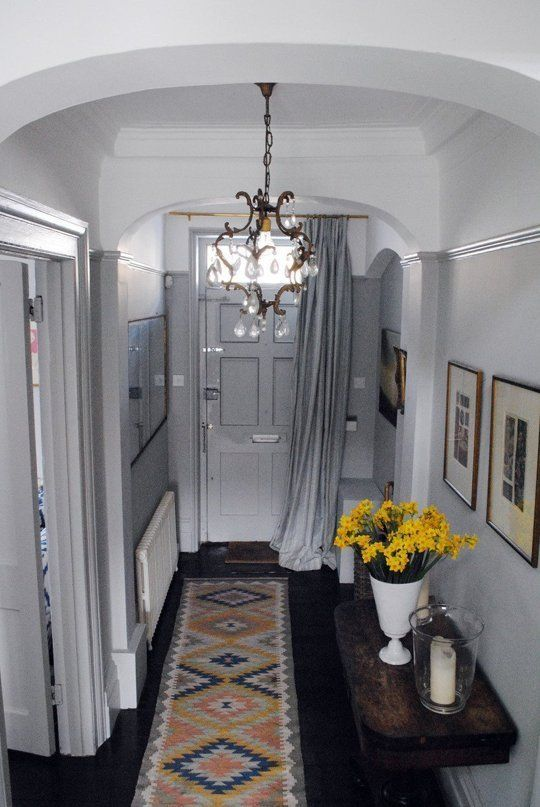 UK Style: 5 Particularly British Design Lessons I've Learned - Apartment Therapy. Removable seasonal drape for the front door. Must find a way to hang one soon!