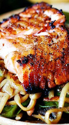 Crispy Asian salmon with stir-fried noodles, pak choi & sugar snap peas