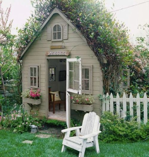 This is not really a garden shed but rather a garden cottage. Even has a white picket fence! So quaint and cute. I continue to have hopes for my own garden shed. LJH
