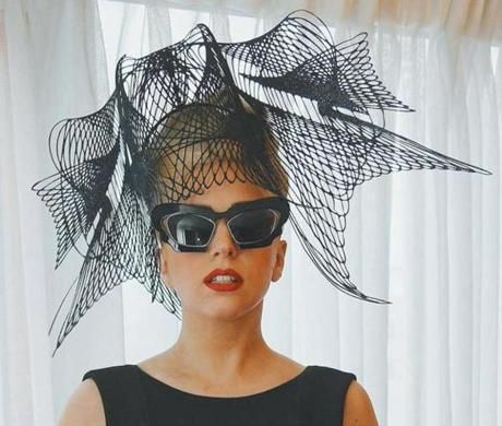 Lady Gaga with a hat created by Philip Treacy.