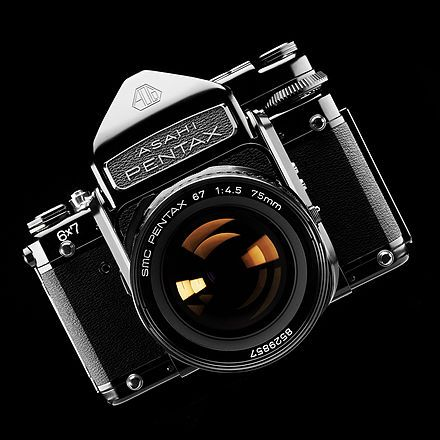 Pentax 6x7. When I was a kid, there was a camera shop in Cambridge that had one of these in the window. It was massive compared to a normal slr and I always wanted one.