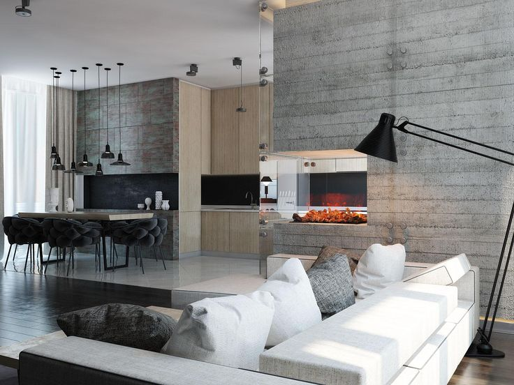 Free of excess ornamentation, this home instead gains its unique character from minimalistic light fixtures of all shapes and styles – functional and beautiful. Here, an architectural floor lamp provides adjustable task lighting over the couch. Its style is reminiscent of the iconic Luxo floor lamp, the same style used in the classic Pixar logo.
