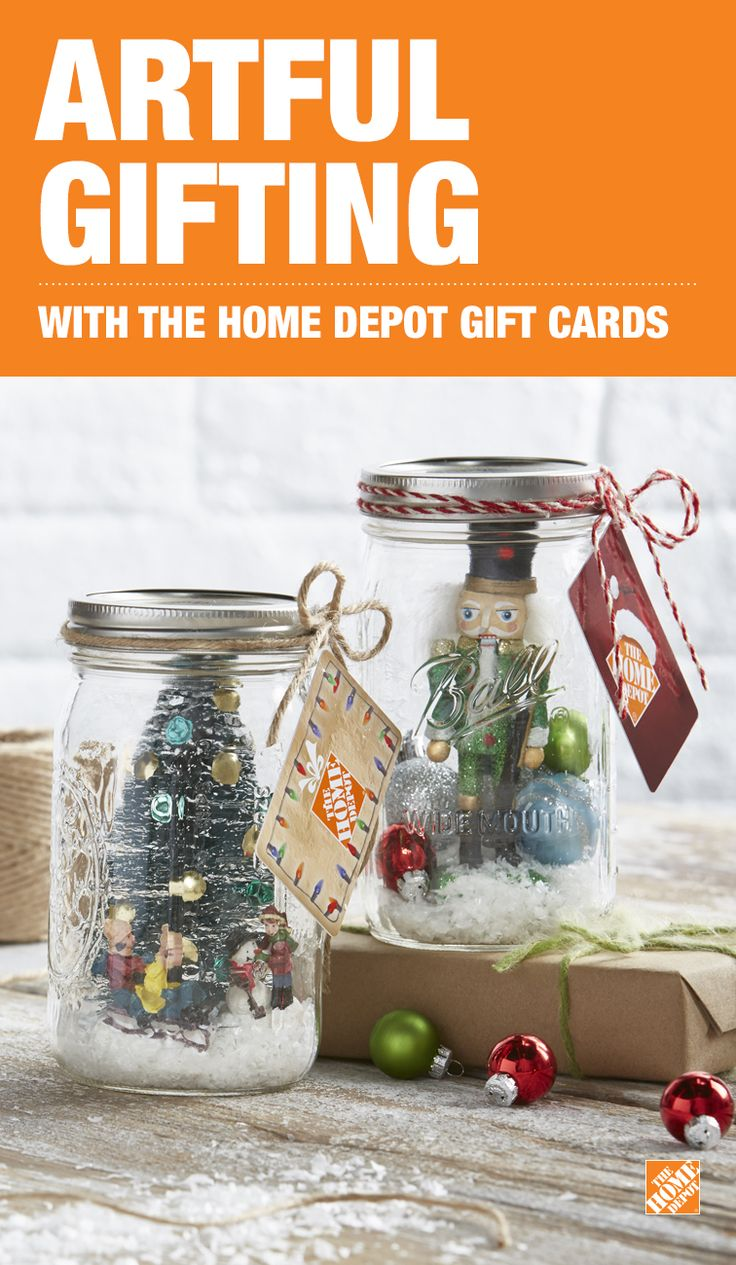 These Merry Mason Jars are the perfect vessel to give a gift card from The Home Depot! Click through this pin to purchase your gift card from The Home Depot now! • First, hot glue a Home Accents Nutcracker Ornament toward the front of the inside of a jar. • Add a small handful of Home Accents Frosty Flurries. • Next, layer in various sizes and colors of Home Accent Christmas Ornaments. • Close the lid, then tie your gift card to the jar with ribbon or string for the finishing touch.