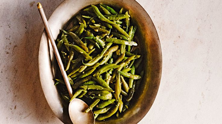 This recipe for sem ki sabzi, courtesy of Madhur Jaffrey, flavors green beans with fresh ginger and fiery green chiles. Beans in India are generally fully cooked and rarely crisp. They absorb the spices much better this way. If you wish to steam the beans instead of parboiling them, do so for about 12 minutes.
