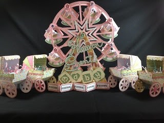 What a great gift for the expectant mother!!  Jeannie's 3D Ferris Wheel is from our SUMMER STREET CARNIVAL SVG KIT.  Baby Carriages and Rocking Horse from the BUNDLE OF JOY SVG KIT.   So cute how she added the Rocking Horses on the cars of the Ferris Wheel!  Beautiful!!!