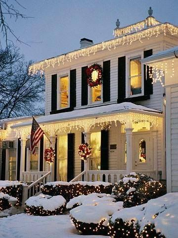 Classic exterior Christmas decor. Lights on eaves. Add wreaths to each window