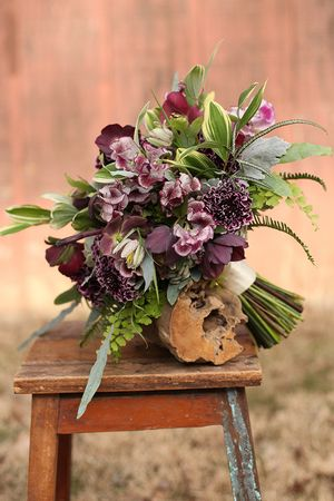Woodland bridal bouquet with fern curls, purple scabiosa, sweet pea, fritillaria, succulents, dusty miller, variegated Solomon's seal and maidenhair fern. By Cincinnati wedding florist Floral Verde. We have everything you need for your Cincinnati dream wedding at www.onestoprent.com/