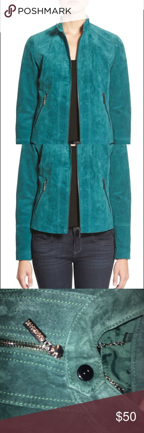 Bernardo Jacket Moto-style jacket, including quilted shoulder panels and trapunto-stitched hem panels, define a fitted jacket cut from soft and supple teal suede. Stand collar, Long sleeves, Front zip closure, and is dry clean only! Fits true to size! Bernardo Jackets & Coats
