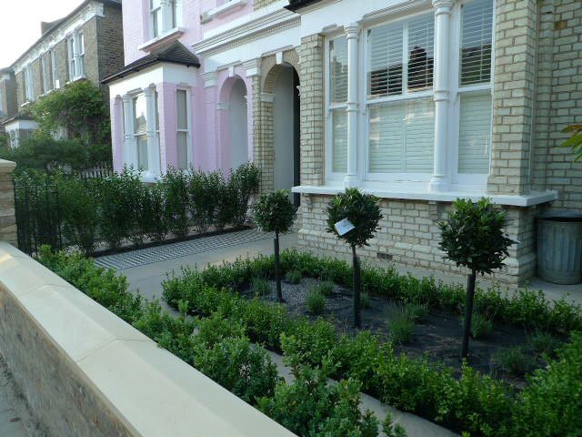 front garden mosaic paving wall caps topiary