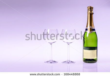 Champagen bottle with two glasses on a purple background by Kasper Nymann, via Shutterstock