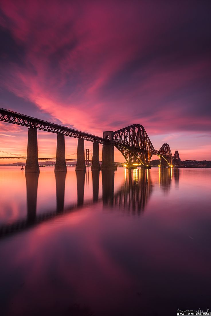 Forth Bridge. The Forth Bridge is a cantilever railway bridge over the Firth of Forth in the east of Scotland, 9 miles west of Edinburgh City Centre. It is considered an iconic structure and a symbol of Scotland.