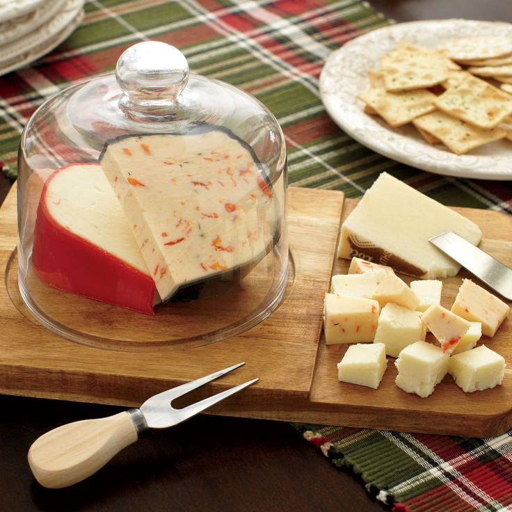 Olson Cheese Board Set | With a clean, simple design, this cheese board and bowl set is expertly crafted of wood and a clear glass domed top. Hand wash.