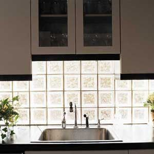 glass block sink backsplash - lets in light and looks cool!